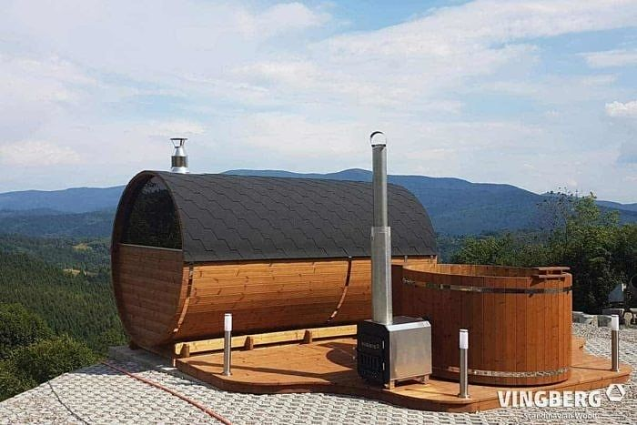 Sauna and hot tub with a mountain view