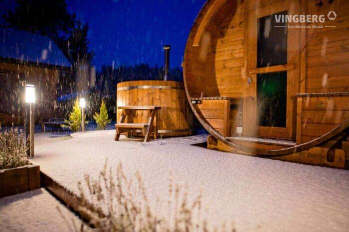 Barrel sauna and hot tub in winter